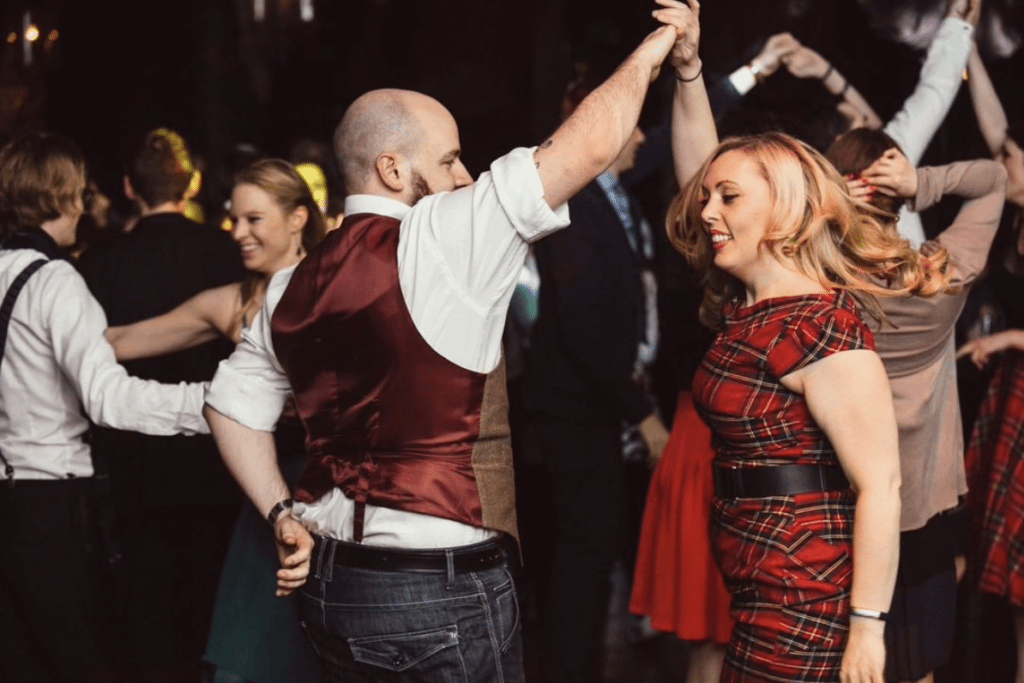 PHoto of people dancing at a ceilidh