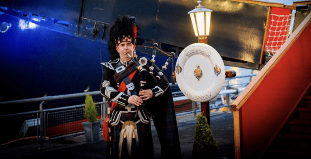 Man playing bagpipes aboard the Royal Yacht Britannia